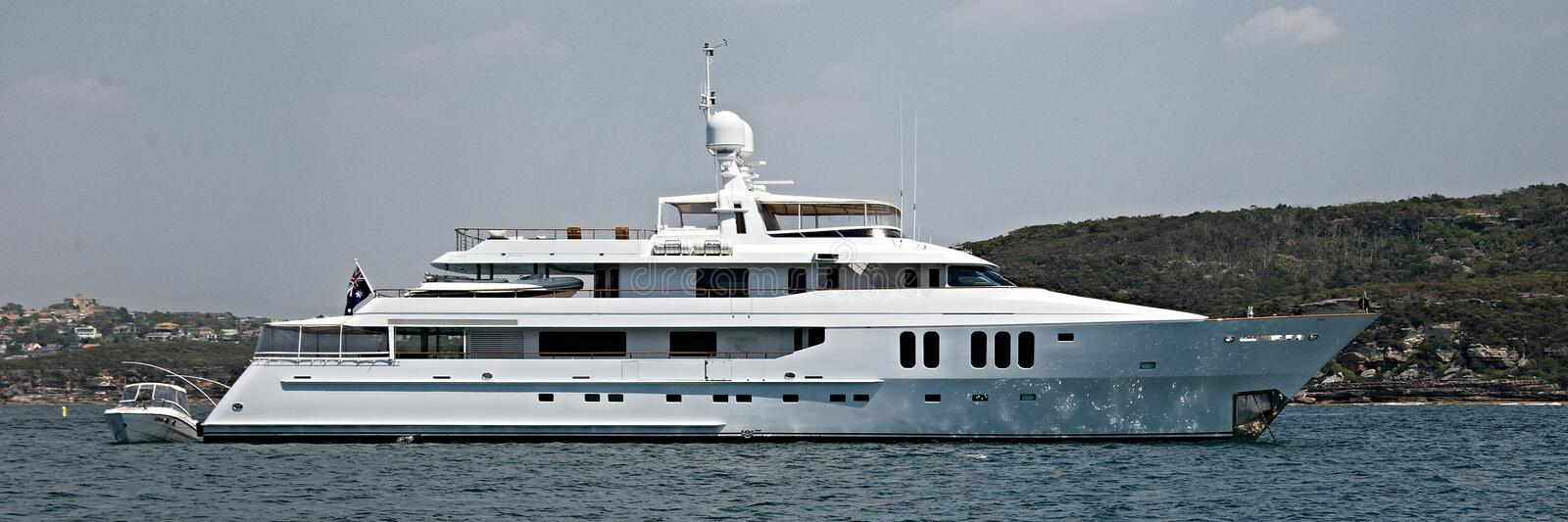 A 90 ton plus, luxury cruising motor Super Yacht at anchor in Sy stock photography