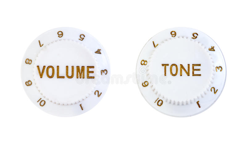 Tone and volume control buttons. Close ups of volume and tone control buttons isolated over white background stock photo
