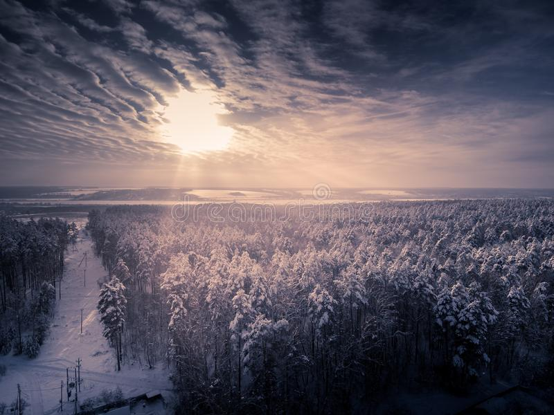 Toned. Aerial view on winter forest and frozen river. Deforestation for power lines.  stock images