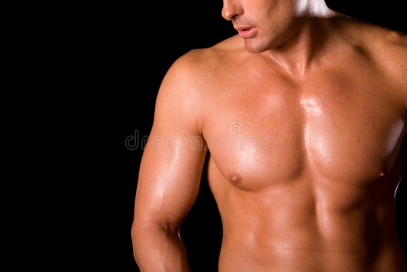 Toned chest. Close up of a man toned chest. Black background stock photos