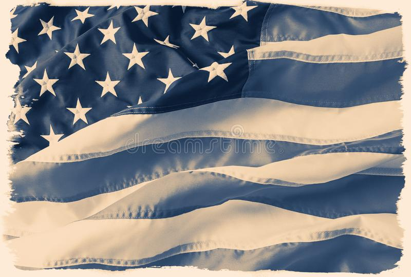 Toned, faded, desaturated American flag with a vintage film border. stock photo