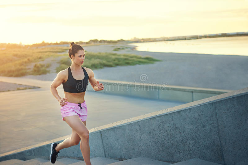 Toned healthy young woman out jogging royalty free stock images