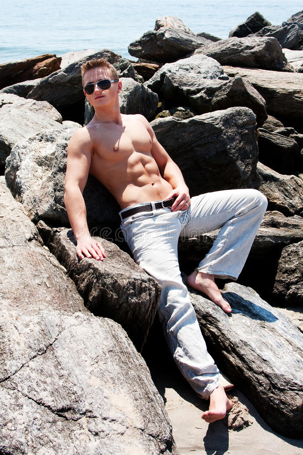 Download Toned man on rocks stock image. Image of relax, caucasian - 9726595