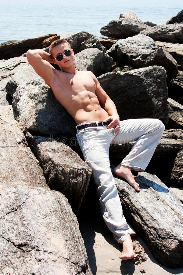 Toned Man On Rocks Royalty Free Stock Image