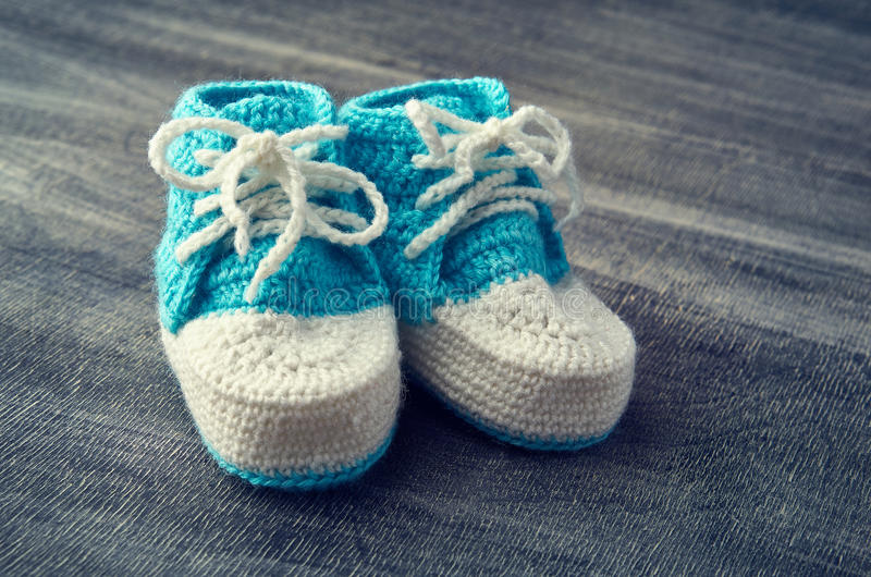 Toned photo of blue child bootees. stock image