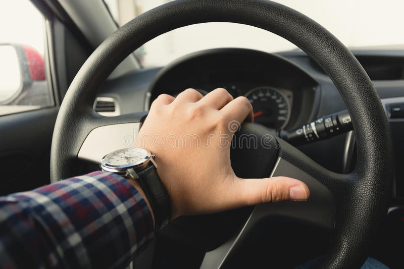 Toned photo of male driver honking the horn. Closeup toned photo of male driver honking the horn royalty free stock photos