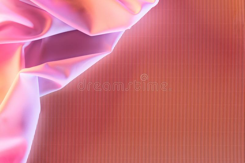 Toned picture of pink soft silk cloth. As backdrop stock photography
