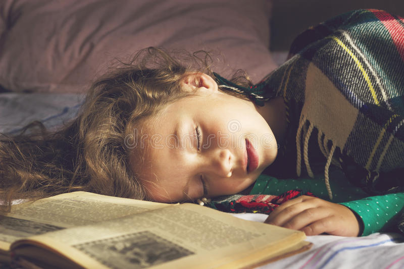 Toned portrait of cute school girl sleeping stock images