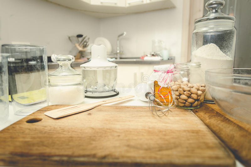 Toned shot of utensils and ingredients for baking on table at kitchen royalty free stock photo
