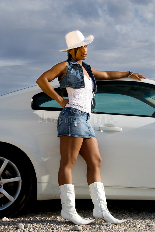 Download Toned woman by car. stock photo. Image of girls, boots - 4152930