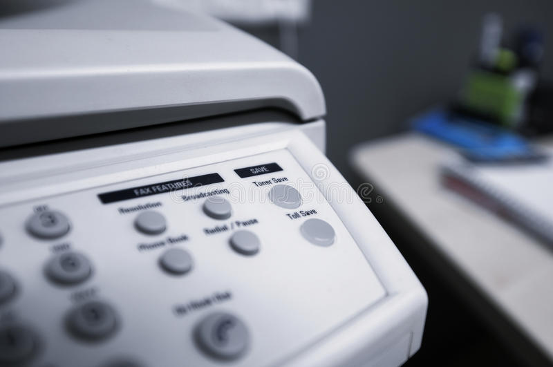 Toner save. This photograph represent a Toner Save button on a fax machine royalty free stock images