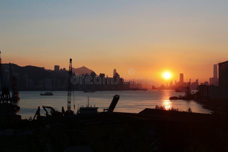 Tong tsai de Kwun macilento do por do sol foto de stock
