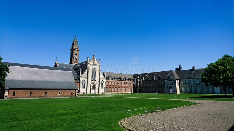 Tongerlo abbey. The inner yard of tongerlo abbey, Belgium, with its mix of buildings through centuries, beginning from 1130 stock photo