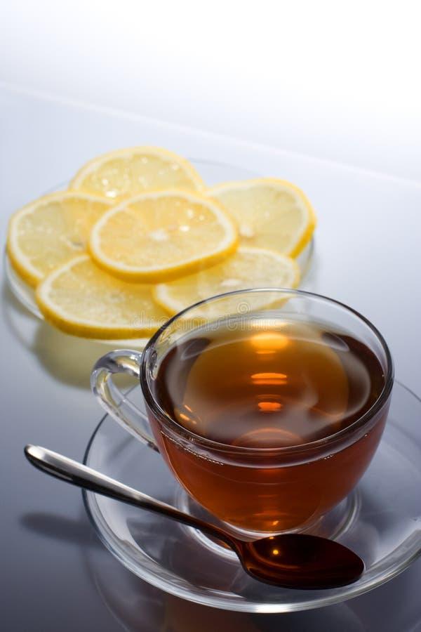 Tonic tea. Cup of hot tea with lemon on saucer royalty free stock photos