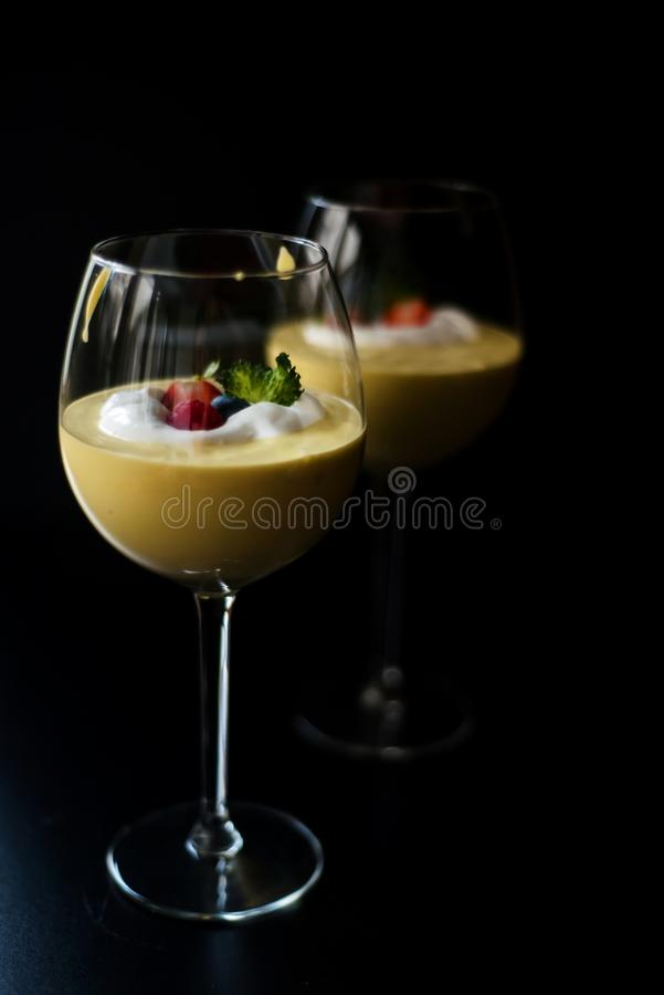 Tonka cream with fruits and whipped cream. In a glass royalty free stock photos