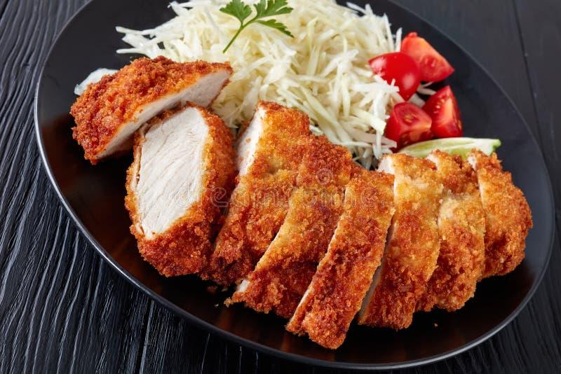 Tonkatsu - le panko a pané la côtelette cuite à la friteuse de porc images stock