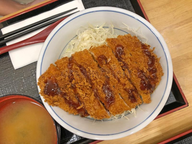 Tonkatsu set, a Japanese dish that consists of a breaded, deep-fried pork cutlet, eat with miso soup royalty free stock images