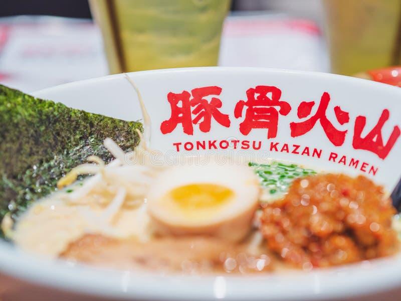 Tonkotsu Kazan Ramen brand name on a white bowl of ramen. royalty free stock photo