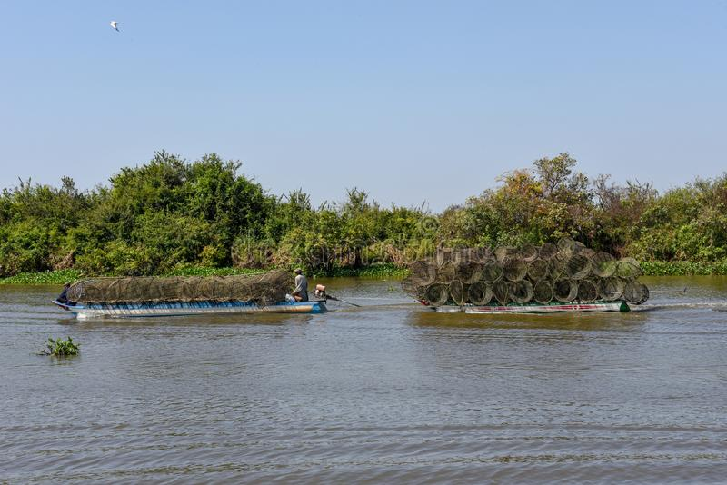 Boat navigating a tributary river to the Tonle Sap lake royalty free stock photography