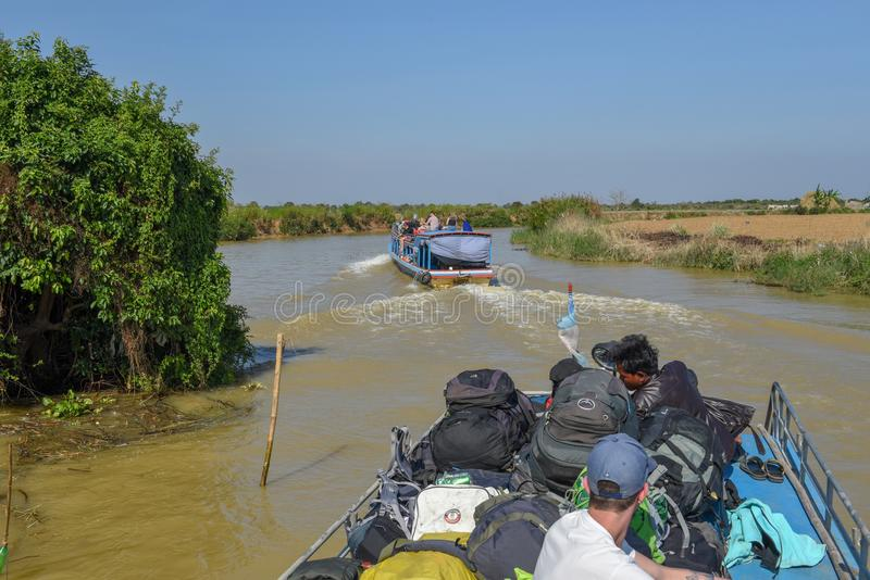 Boat navigating a tributary river to the Tonle Sap lake stock image