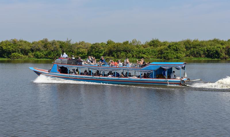 Boat navigating a tributary river to the Tonle Sap lake stock images