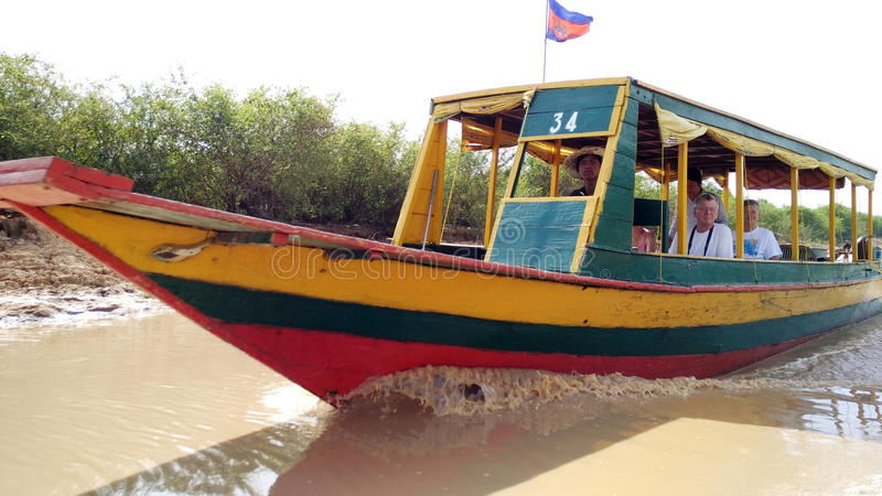 Tonle Sap lake. Tourist boat on a floating village on Tonle Sap lake in Siem Reap, Cambodia stock image