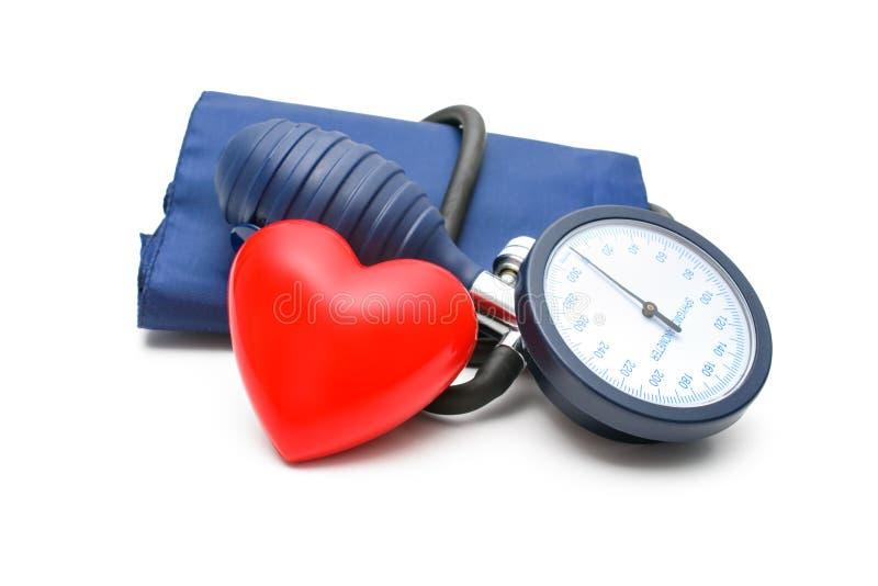Tonometer e coração imagem de stock