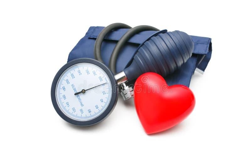 Tonometer y corazón imagen de archivo libre de regalías