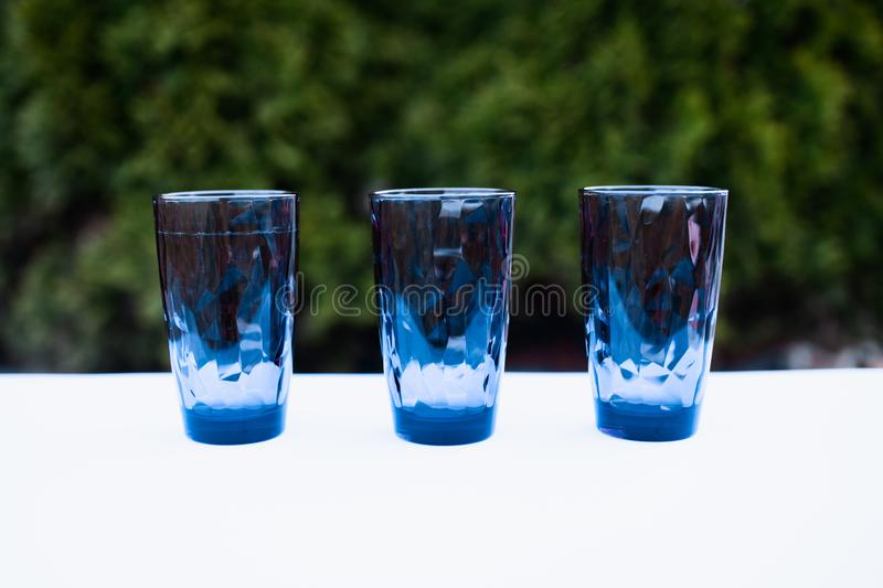 3 tons of glasses in nature, summer dishes, colorful dishes, Copy Space royalty free stock photos