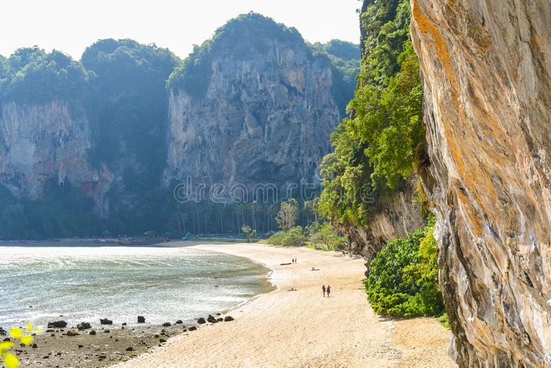 Tonsai Beach in low season. Traveling in Krabi, Thailand. Tonsai Beach in low season July. An almost empty strip of sand, steep cliffs, and jungles. Ton Sai is a stock images