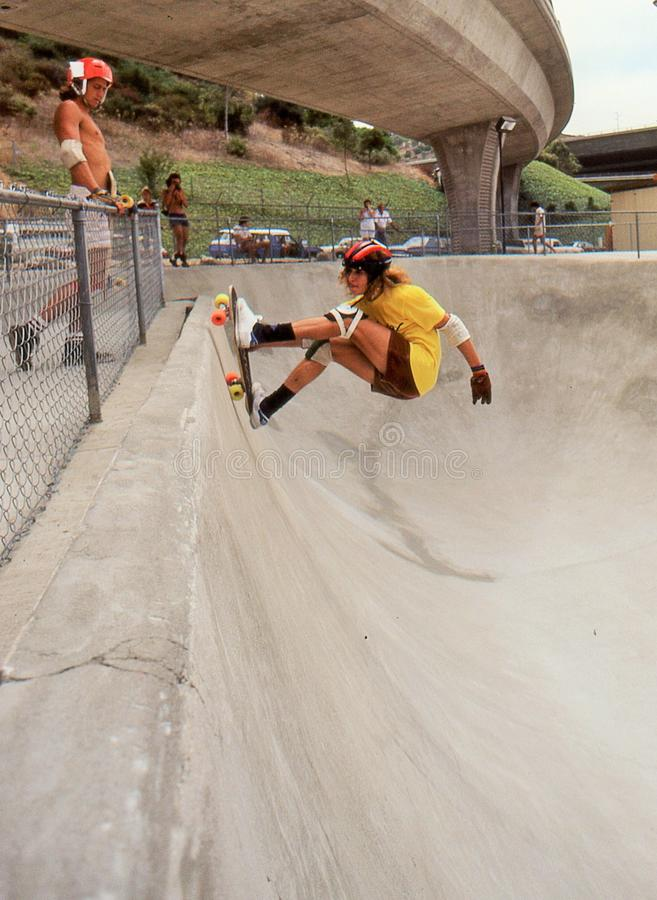 2 Tony Alva in the half pipe catching air at Oasis. 2 of 6 sequence Tony Alva catching air while riding the half pipe at Oasis Skate Park in San Diego, August stock photos