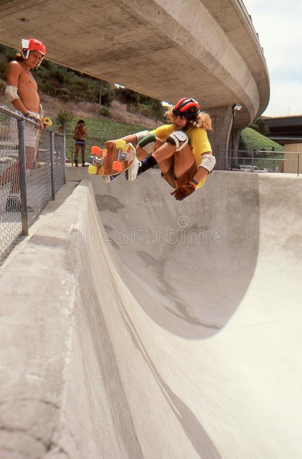3 Tony Alva in the half pipe catching air at Oasis. 3 of 6 sequence Tony Alva catching air while riding the half pipe at Oasis Skate Park in San Diego, August royalty free stock photography