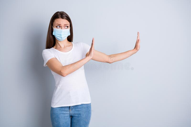 Too close. Photo of serious lady keep social distance avoid afraid of people contact raise arms side empty space stand royalty free stock images