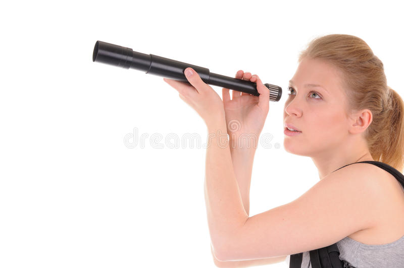 It is too far away. Nice blonde girl is looking far away throught telescope on white background royalty free stock photo