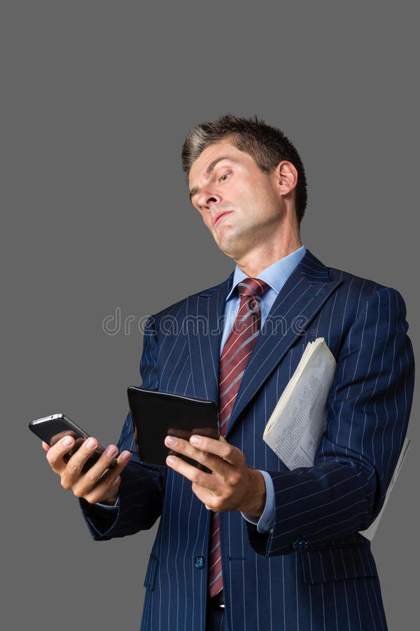 Too many instances. Businessman thinking about having too many instances stock image