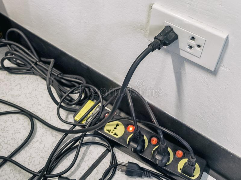 Too many plugs in a socket royalty free stock image