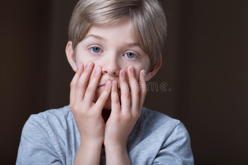 Too many problems. Little boy has too many problems in his life royalty free stock images