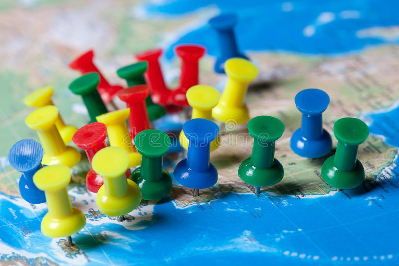 Too many pushpins in a map stock photography
