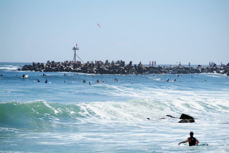 Too many surfers. Hoards of surfers out surfing Manasquan Inlet royalty free stock photography