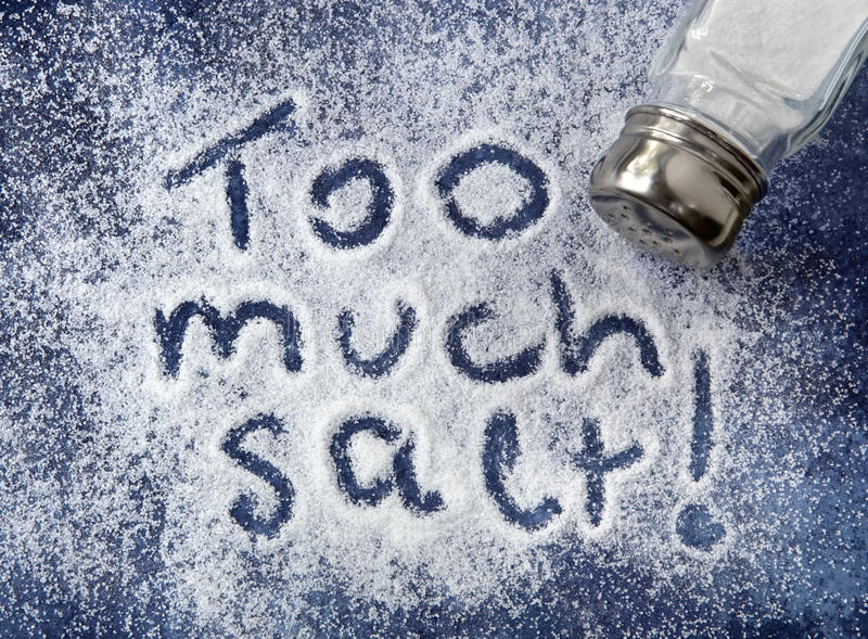 Too Much Salt. ! written in salt, with shaker. Warning related to diabetes, high blood pressure, etc stock images