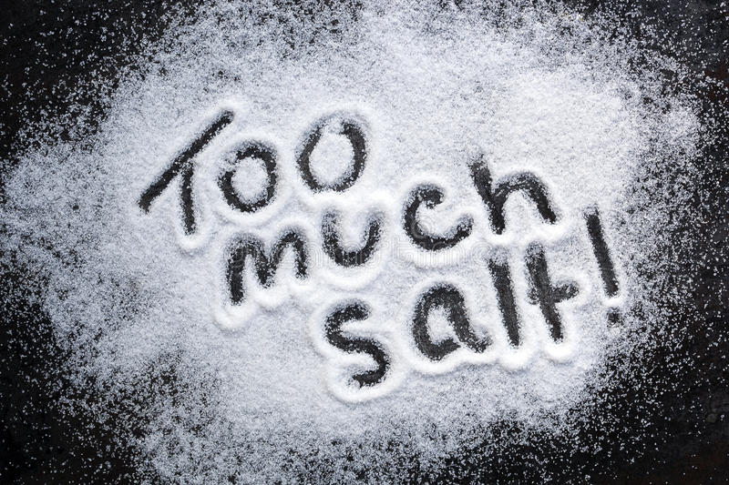 Too Much Salt. Words too much salt, warning about excessive consumption stock images