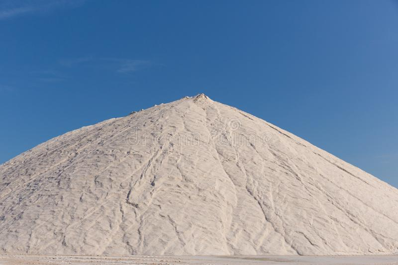 Too much salt on your food. ? Store of processed salt ready to be bagged and distributed royalty free stock photography