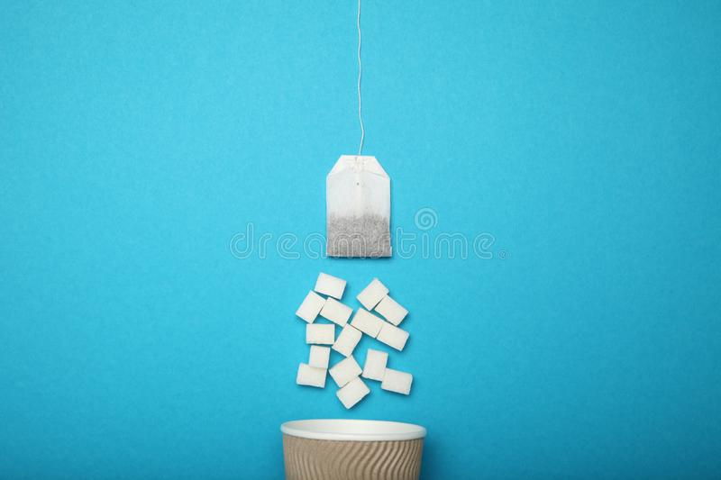 Too much sugar in tea cup. Unhealthy fast food concept.  royalty free stock photography