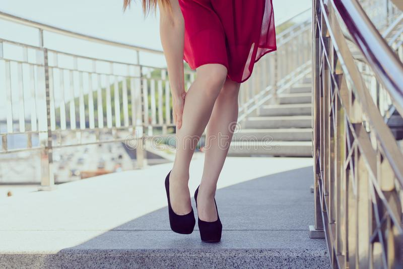 Too small big highheels rubbing callus stand concept. Low angle close up front photo portrait of pretty beautiful unhappy sad lady stock image