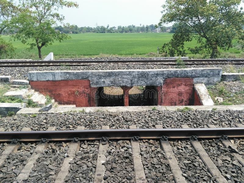 Railway tracks through village and farms. stock images