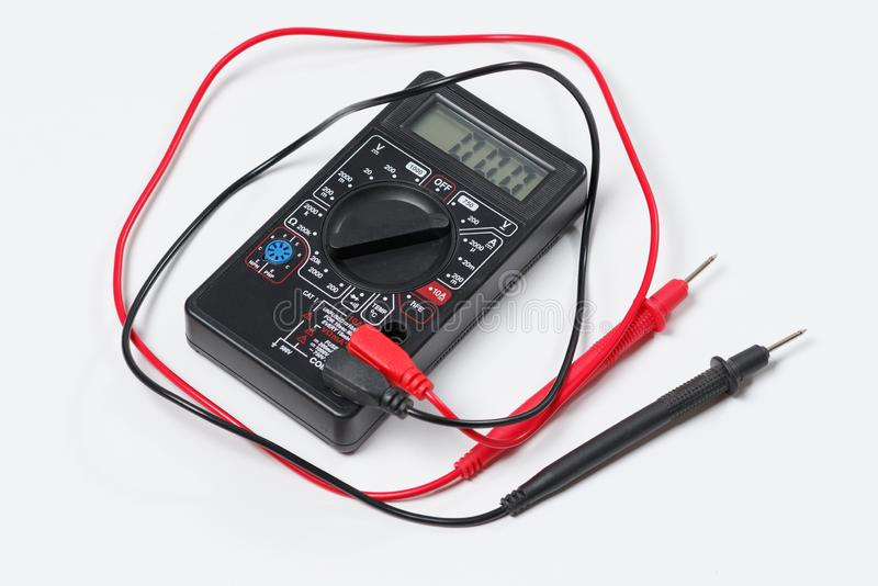Tool for checking electrical circuits. Digital multimeter on white background stock photo