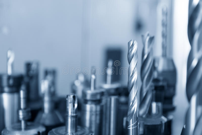 The tool for CNC milling machine. In the blue scene.The various type of cutting tool royalty free stock image