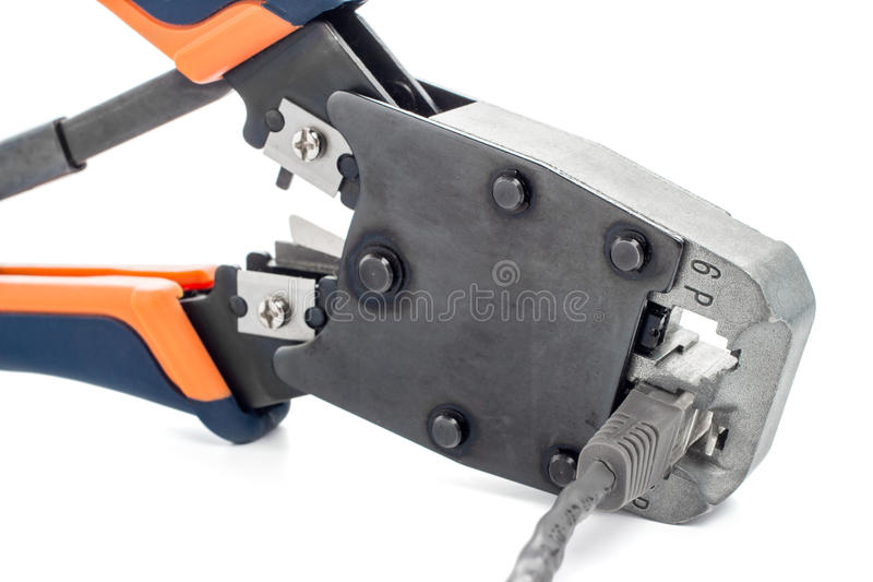 Tool. Crimping tool for twisted pair on a white background, isolated royalty free stock photo