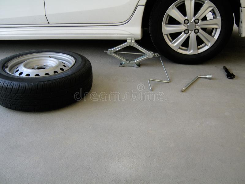 Tool kit for changing car tires. royalty free stock photo