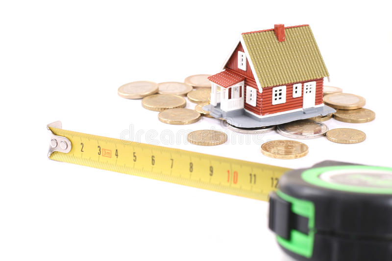 The tool for measurement of length, coins and litt. Le house over white stock photos